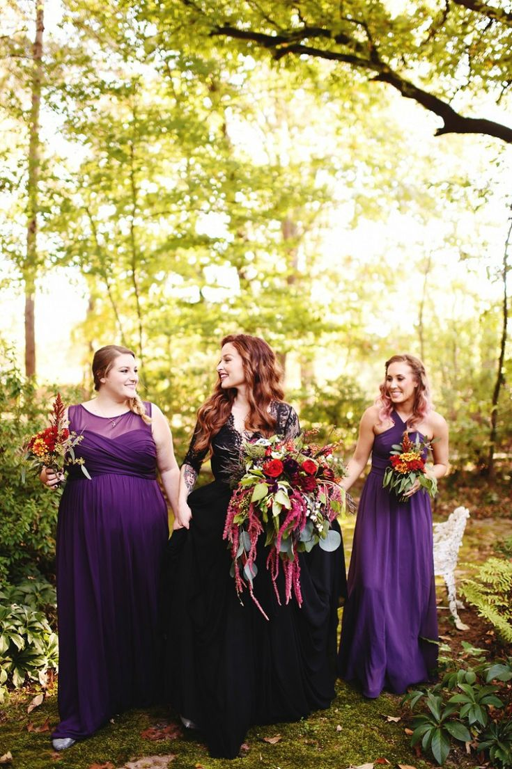 be bold. make a statement with a black bridal gown and a halloween-themed wedding || purple, red, black, greenery, halloween
