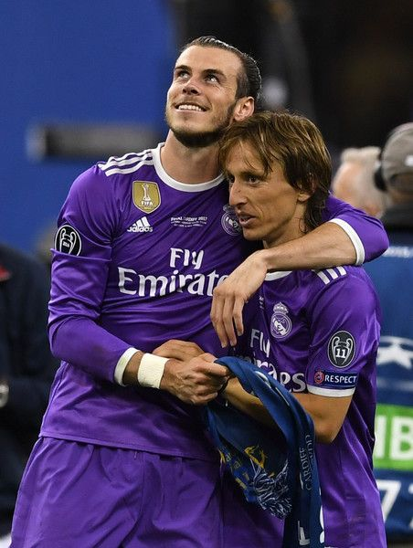 Gareth Bale of Real Madrid and Luka Modric of Real Madrid embrace after the UEFA Champions League Final between Juventus and Real Madrid at National Stadium of Wales on June 3, 2017 in Cardiff, Wales.