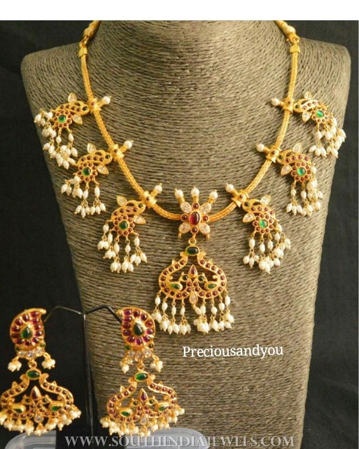 Simple gold plated guttapusalu necklace set. For inquiries please contact the seller below. Seller Name : Precious and You Instagram : https://www.instagram.com/preciousandyou/ Contact : +917094196623 Website : http://www.preciousandyou.com/ Facebook : https://www.facebook.com/preciousandyou/ Related PostsAntique Gold Plated Attigai NecklaceGold Plated Kundan Necklace Set with PriceStone Mango Necklace Set 2017 ModelGold Plated Silver Rub...