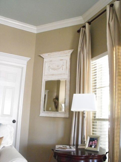 Wall color Relaxed Khaki by Sherwin Williams and ceiling color Rain Wash by Sherwin Williams.