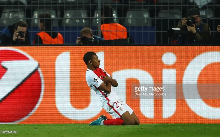 Kylian Mbappe of AS Monaco celebrates after scoring his team's third goal of the game during the UEFA Champions League Quarter Final first leg match between Borussia Dortmund and AS Monaco at Signal Iduna Park on April 12, 2017 in Dortmund, Germany. The match was rescheduled after an alleged terrorist attack on the Borussia Dortmund team coach as it made it's way to the stadium.