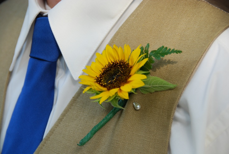 Sunflower boutonniere on tan vest with navy tie; great summer groom attire
