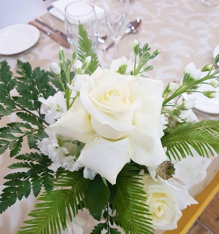 modern white rose and lush green wedding centerpiece