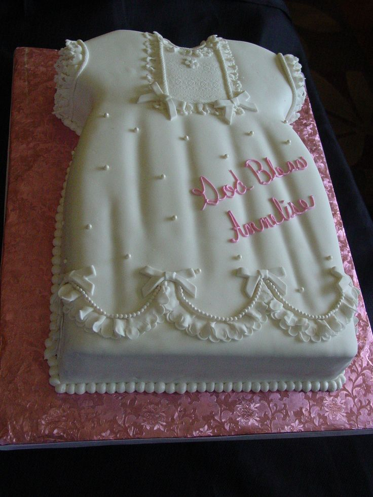 Annelise Baptism - Carved a 1/2 sheet  lemon cake and cover with fondant all the details were done with fondant too.