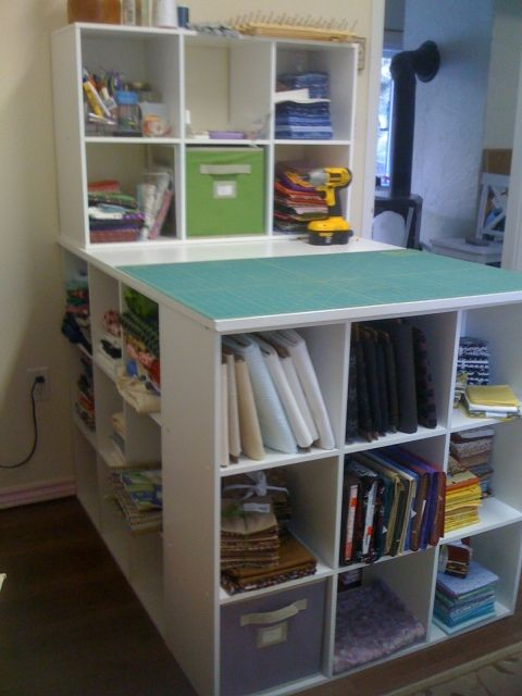 3 Open backed cubbies screwed together in a U shape - top with a 3 foot x 4 foot board for cutting & storage station - optional - add a 4th cubbie on top