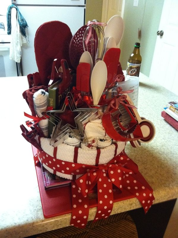 Wedding Shower Gift. -no link but you simply collect all kinds of kitchen items and place them inside a round cake pan lined with a towel. Wrap another towel around the pan and tie a cute ribbon around it. Place on top of a cookbook and a cutting board. Viola... instant gift bundle!