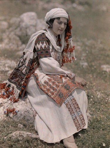 A young woman adorns the dress of the Peloponnesian Greeks from Nemea. National Geographic's Greece in Color from the 1920s Photographer: Maynard Owen Williams in the 1920s