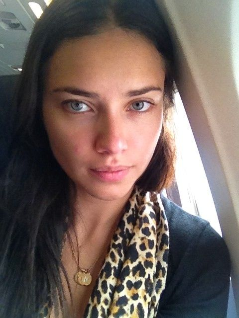 adriana lima without makeup - a reminder that just about ANYONE can be made to look like a Victoria's Secret supermodel (just need a professional make-up artist and photoshop). ;)