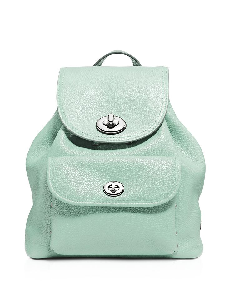 Coach Pebble Mini Turnlock Backpack  | Leather | Imported | Top handle, adjustable shoulder straps | Flap with turnlock closure, drawstring top | Front flap pocket with turnlock closure; interior feat