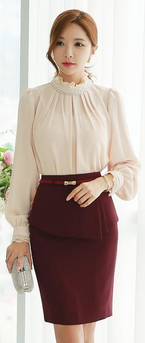 Pepplum and top with tucks , sleeve cuffs, loose sleeves.
