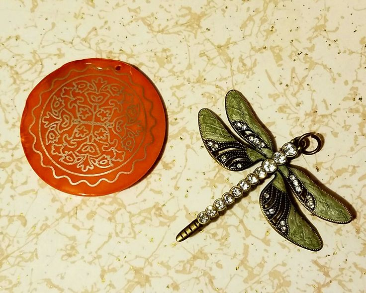 And then there are these gorgeous pendants! The orange on is a pearlized vintage pendant, orange has always been difficult for me to work with, so it is a nice challenge for me. The  dragon fly is actually one I have eyed myself before so I am thrilled to have it, it should be easy for me to use - I guess we shall see what I come up with! Thank you Jackie!