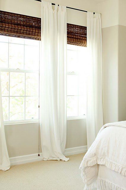 White curtains and brown wooden blinds.