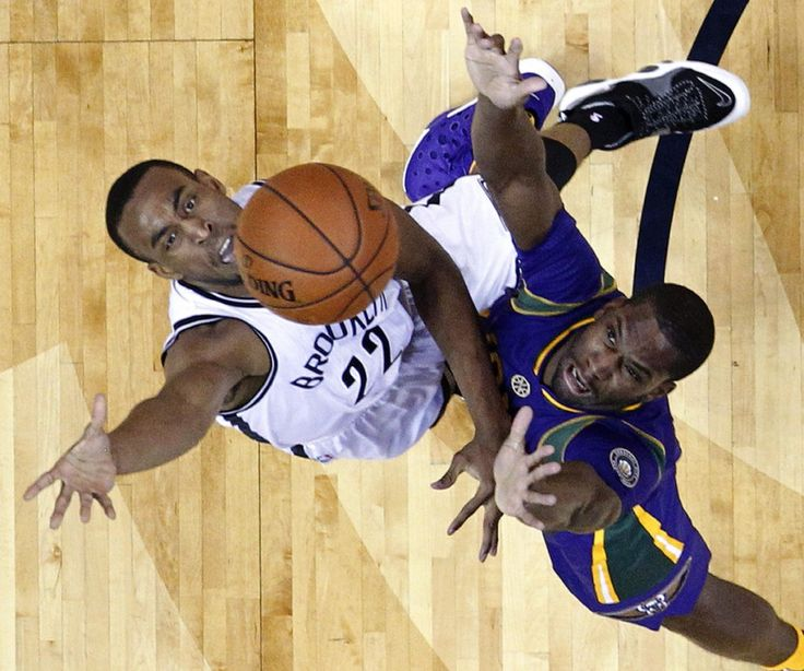 Brooklyn Nets guard Markel Brown (22) battles against New Orleans Pelicans guard Toney Douglas in the first half of an NBA basketball game in New Orleans, Saturday, Jan. 30, 2016. (AP Photo/Gerald Herbert)