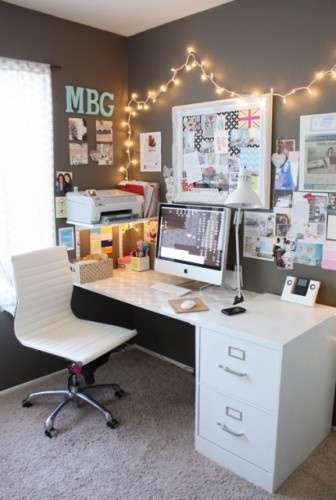 Desk is small scale; file cabinet looks like part of the desk. Printer is off the desktop. The dark color on the wall helps make everything on the wall look intentional and organized.