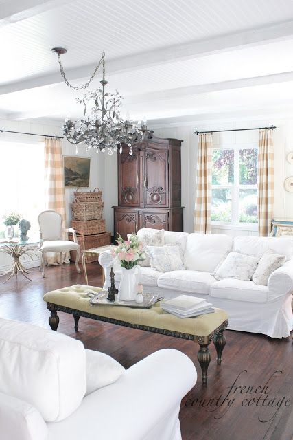 This is an article about slipcovers, but I pinned because I love the curtains and curtain rods.
