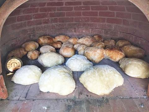 Baking bread in a wood fired brick oven