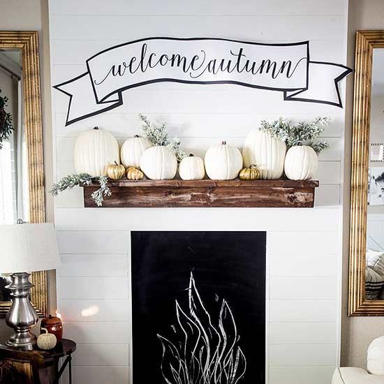 Who says fall has to be all about warm colors? These white and gold pumpkins and touches of greenery add the perfect autumnal touch, along with the free fall printable banner from Just Destiny.