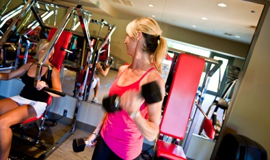 Work out with weights in the Fitness Center.