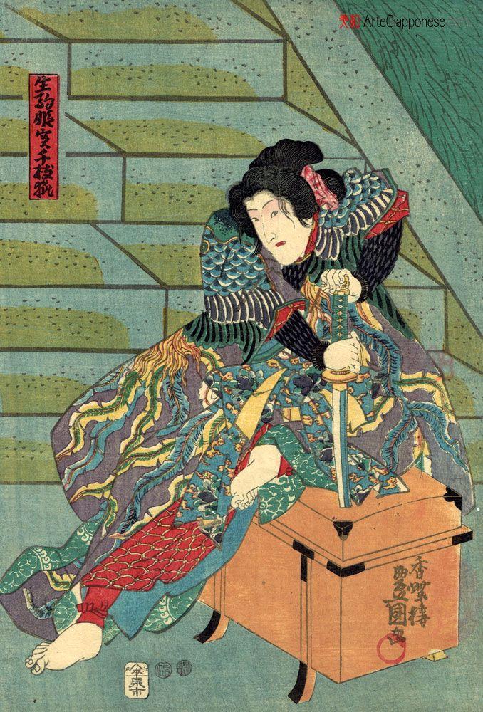 """Principessa Ikoma.originale del 1850, realizzata dal celebre maestro ukiyo-e Utagawa Kunisada (歌川国貞) e raffigurante l'attore Iwai Kumesaburo III (三代目岩井粂三郎) che interpreta il ruolo della volpe Chie (千枝狐), trasformatasi magicamente nella principessa Ikoma (生駒姫), nell'ambito dell'opera di teatro kabuki """"I fiori di Yoshino"""" (花際吉埜), messa in scena nel novembre del succitato anno presso il Teatro Nakamura )di Tokyo."""