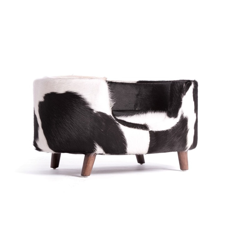 Fido Lounger - For all of you with pups, pamper them with this stylish cow hide dog bed. Finally, a cozy and cute sleeper for your loyal friend that you won't want to push under the couch or throw in the closet when your guests arrive.