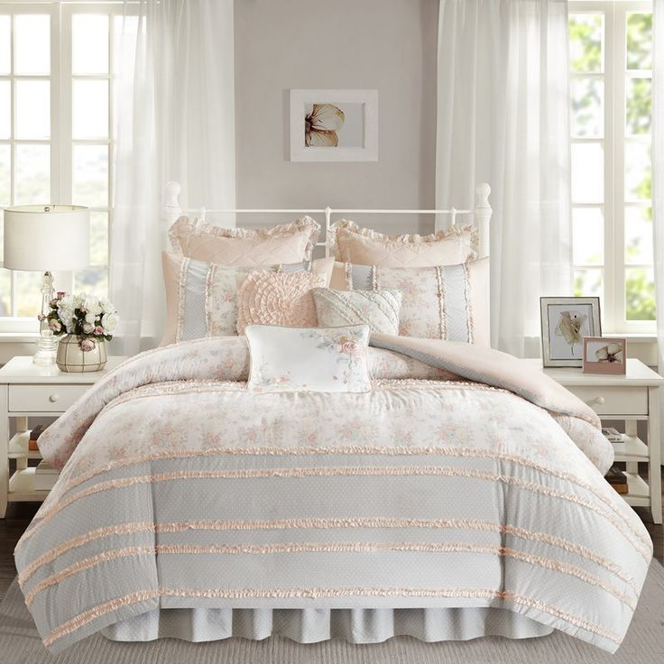Give your mattress a country-chic makeover with this stylish duvet cover set. Made from cotton percale, this bucolic bedding set includes one coverlet and two shams in wide pattern-mixed stripes of floral print, polka dot, and soft solid hues, with button closures and piecing detail, and three decorative pillows featuring pinched pleating, lacy embroidery, and elegant piping. For a perfectly pastoral bedroom ensemble, roll out a rustic jute area rug to define the space, then use this set to…