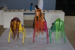 Play at Home Hair Salon - let them cut the hair from the dollar store!! Genius!