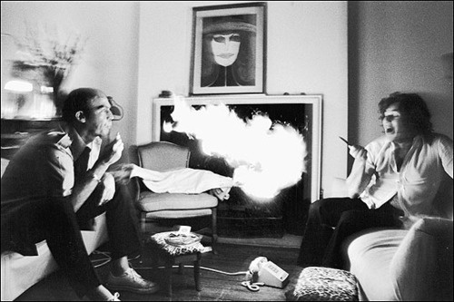 Hunter Thompson exhaling lighter fluid at Jann Wenner