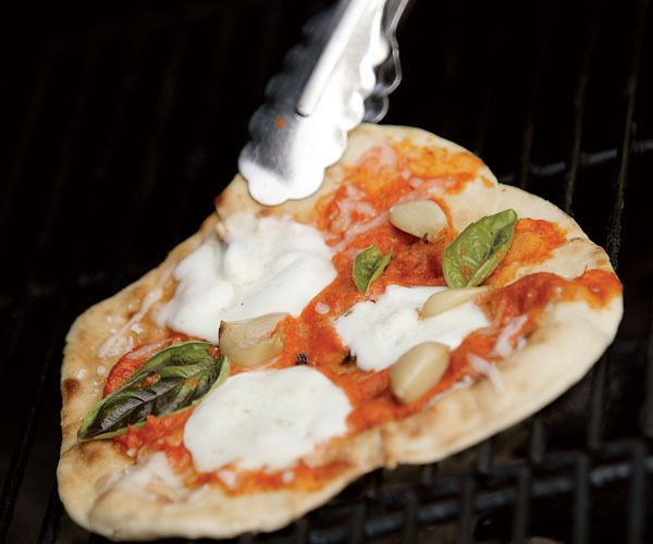 Grilled Pizza with Roasted Red Pepper, Garlic & Fresh Mozzarella by Fine Cooking. If you're pressed for time, you can easily make this pizza with store-bought dough.