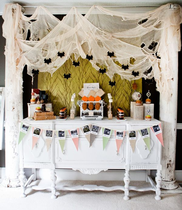 I love the entire party, but especially the cheesecloth backdrop! #Halloween