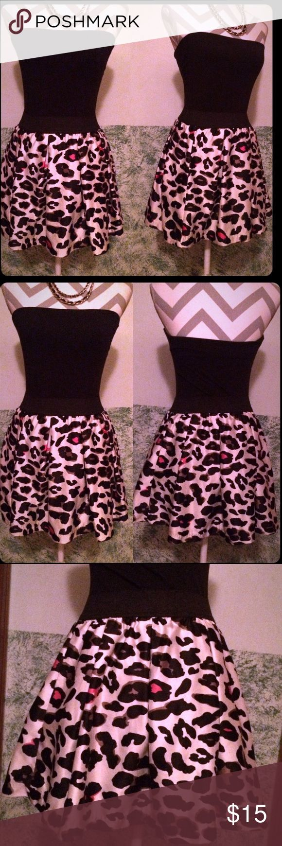 2 for 1! Express black tube top and leopard skirt This listing is for BOTH items shown.  One XS Express basic black strapless top with shelf bra insert.  Second, XS satiny leopard print mini skirt from forever 21 with black stretchy band waist and black lining.  Skirt is a cream color with black and pink leopard print.  Cute outfit together, basic black top is versatile. Express Skirts Skirt Sets