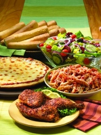 O's American Kitchen's Family Combo Meal includes pizza, pasta, chicken, salad and breadsticks. [http://nrn.com/article/former-pat-oscars-franchisees-launch-new-concept]