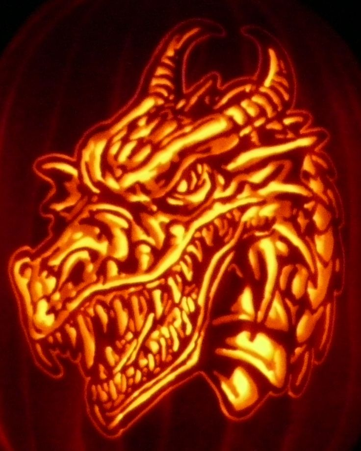 I wanted to carve a dragon for years, so here's one from a stoneykins.com pattern I carved on a foam pumpkin.