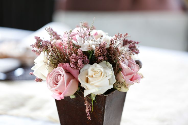 Beautiful Dusty Pink and White Rose Flower Arrangement for a Rustic Wedding.
