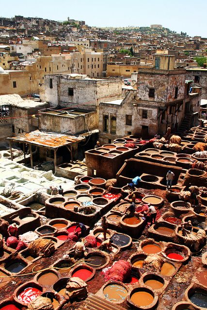 "Fez, Morocco - North Africa. ""We saw all of these handmade buckets of dye. The slaves + workers (who were underpaid + so skinny + frail) would dye the leather in these buckets. This is how they get such rich colors over there. it was beautiful to see in person, but Fez is the scariest place I have ever been on earth."" I want to go here so badly.."
