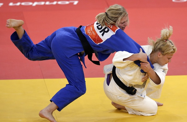 USA's Kayla Harrison (in white) competes against Gemma Gibbons of Great Britain for the gold medal during the women's 78-kg judo competition at the 2012 Summer Olympics, Thursday, Aug. 2, 2012, in London. Harrison won the gold and Gibbons won the silver.  She is the first American to earn an Olympic gold medal in judo    #olympics, #judo, #london2012