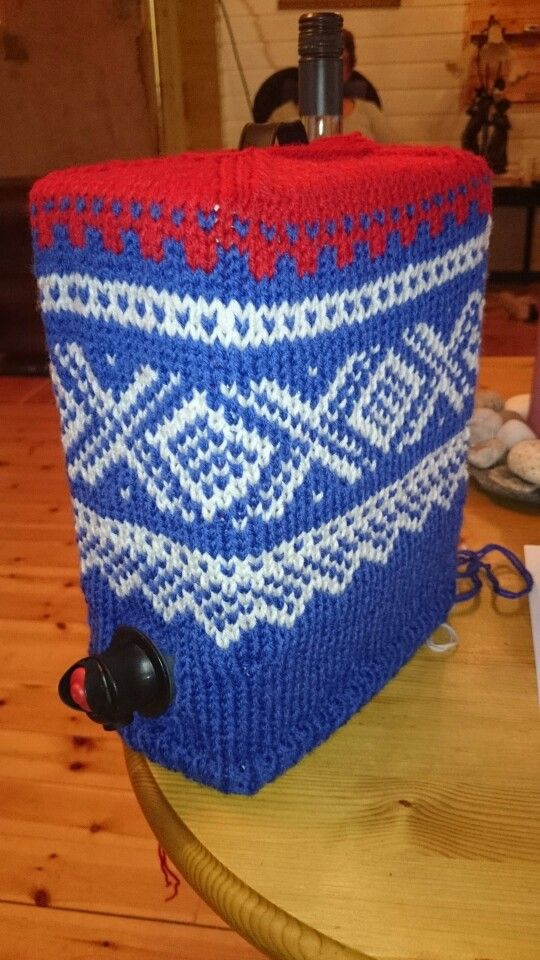 Knitted cover in Marius pattern for wine box.