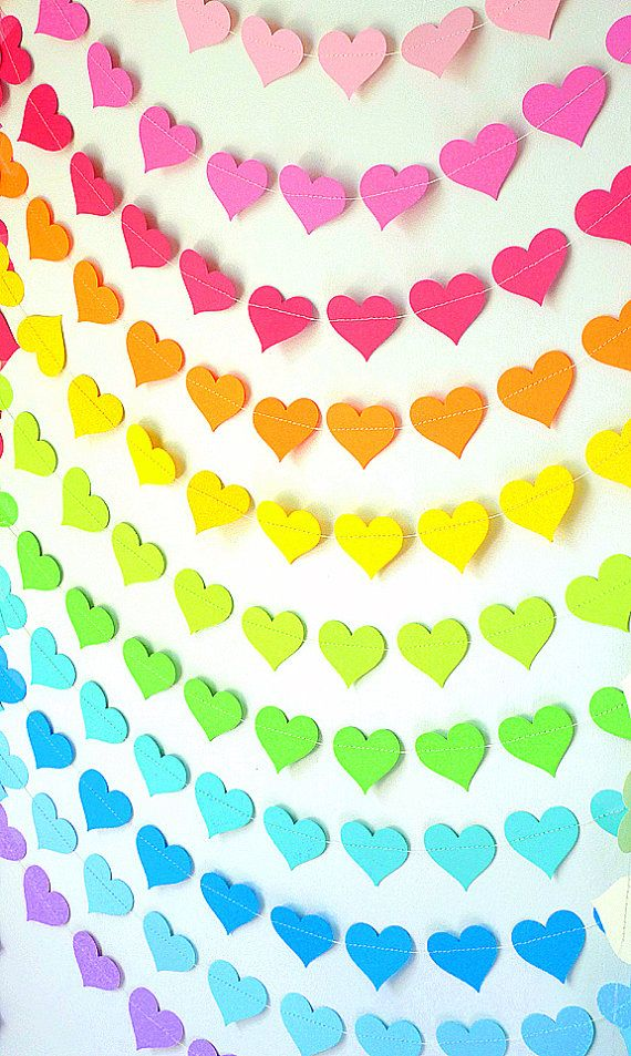 A vibrant, wonderfully cheerful rainbow created from strings of heart garland. #rainbow #hearts #Valentines