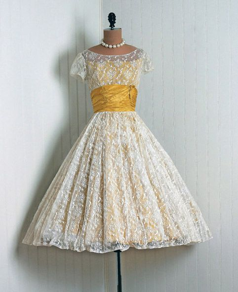 I REALLY like this dress...and am sorta considering making one similar, except maybe with burgundy instead of the yellow....but it'd be modest, has lace....and looks fun to spin in... <3