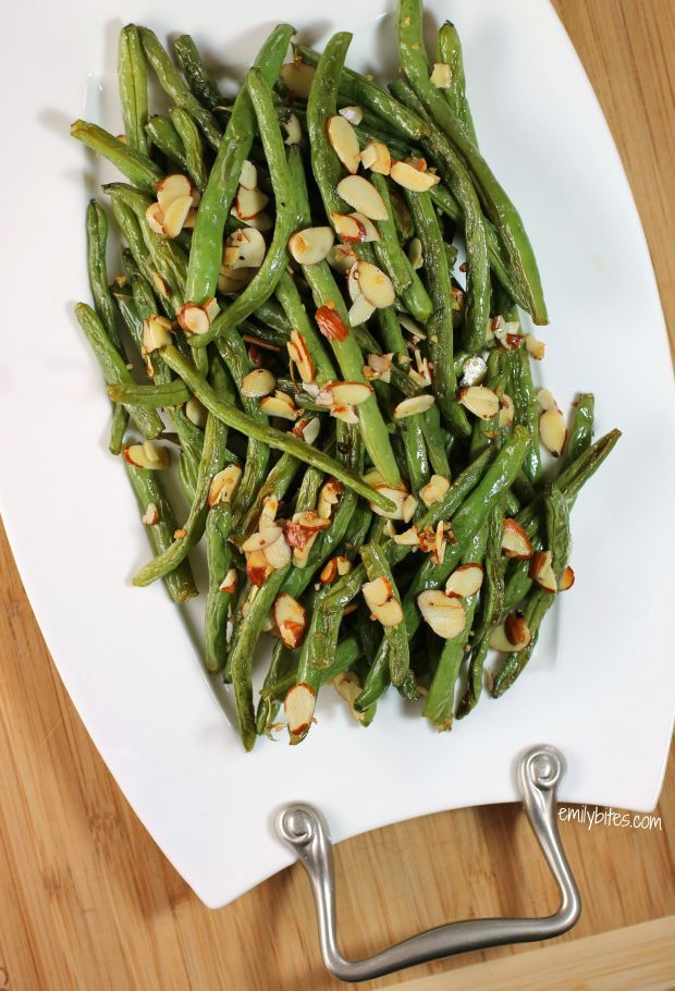 These Garlic Roasted Green Beans with Almonds are healthy, flavorful, and so easy to make! Only 80 calories or 2 Weight Watchers SmartPoints per serving. www.emilybites.com #healthy