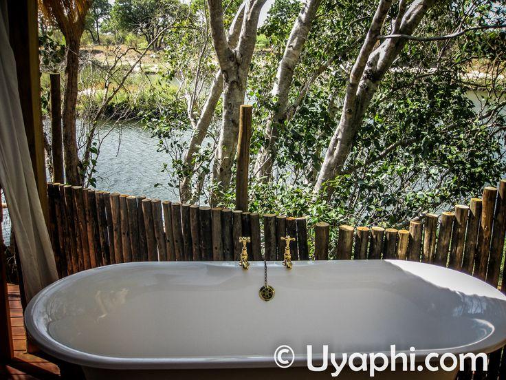 A bath with a view of the Zambezi River :) http://www.uyaphi.com/zambia/lodges/sindabezi-island-camp.htm
