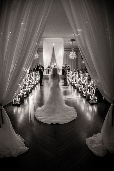 We love this unique twist: The bride entered the ceremony by herself, then met her parents halfway down the aisle!
