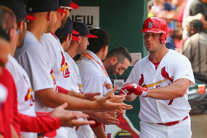 Matt Holliday is congratulated by teammates after hitting a solo home run in the fourth inning against the Chicago Cubs. Cards won the game 9-6.  8-31-14