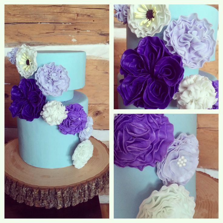 Pale Blue and Violet tones, I made this cake envisioning a whimsical bride who isn't afraid of colour - lots of ruffle flowers and one large statement flower, small pearl details  Wedding or Engagement Cake  www.crumbandberry.com