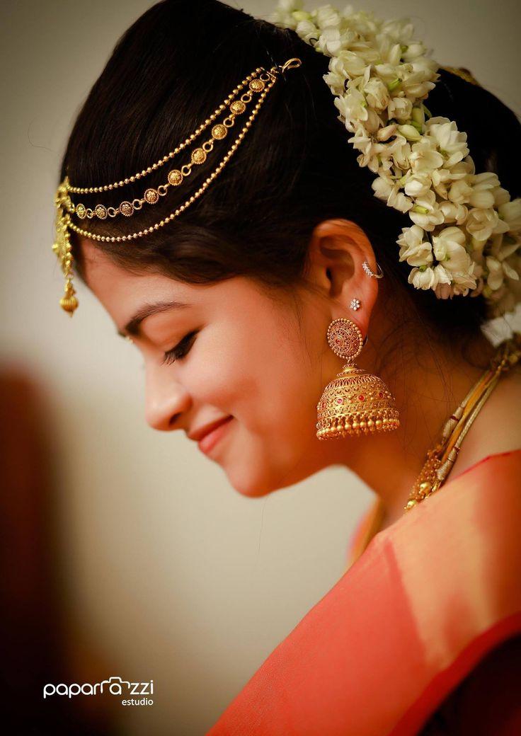 South Indian bride. Gold Indian bridal jewelry.Temple jewelry. Jhumkis. Red silk kanchipuram sari.Braid with fresh jasmine flowers. Tamil bride. Telugu bride. Kannada bride. Hindu bride. Malayalee bride.Kerala bride.South Indian wedding.