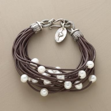 unique pearl bracelet. What if i did this with black cord for the wedding as necklaces for the bridesmaids?