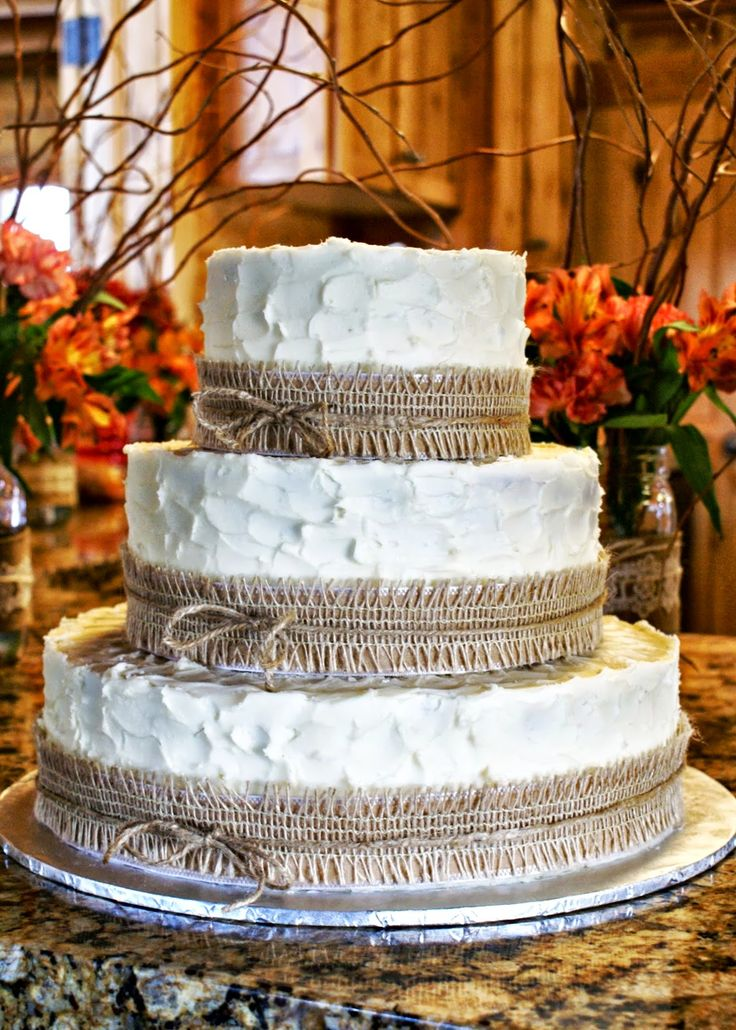 Rustic Burlap Wedding Cake- with lace ribbon around the burlap instead of the haystring