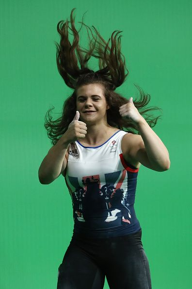 #RIO2016 Rebekah Tiler of Great Britain celebrates after lifting during the Women's 69kg Group B weightlifting contest on Day 5 of the Rio 2016 Olympic Games...