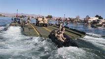 Marines with Bridge Company, 7th Engineer Support Battalion, 1st Marine Logistics Group, drive a Combat Rubber Raiding Craft onto the back of an Improved Ribbon Bridge during a training exercise on the Colorado River in Laughlin, Nev., #USMC #USMarines