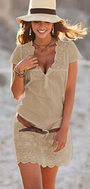 Great tan dress with eyelet trim, perfect for the beach. Would look great in photos with sand and ocean.