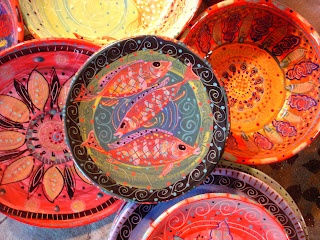 beautiful painted pillows and dishes